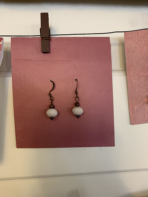 brown and white brass hardware earrings