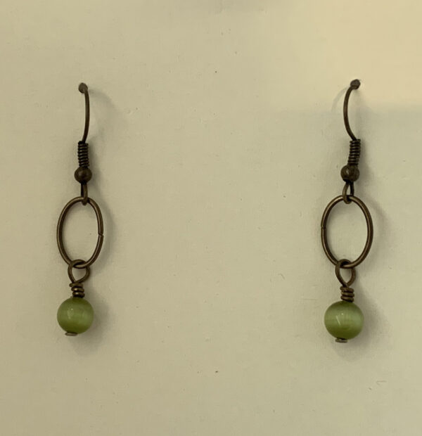 brass earrings with green beads
