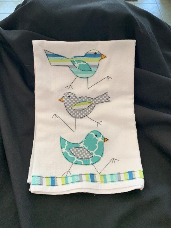 dish towel with three birds running